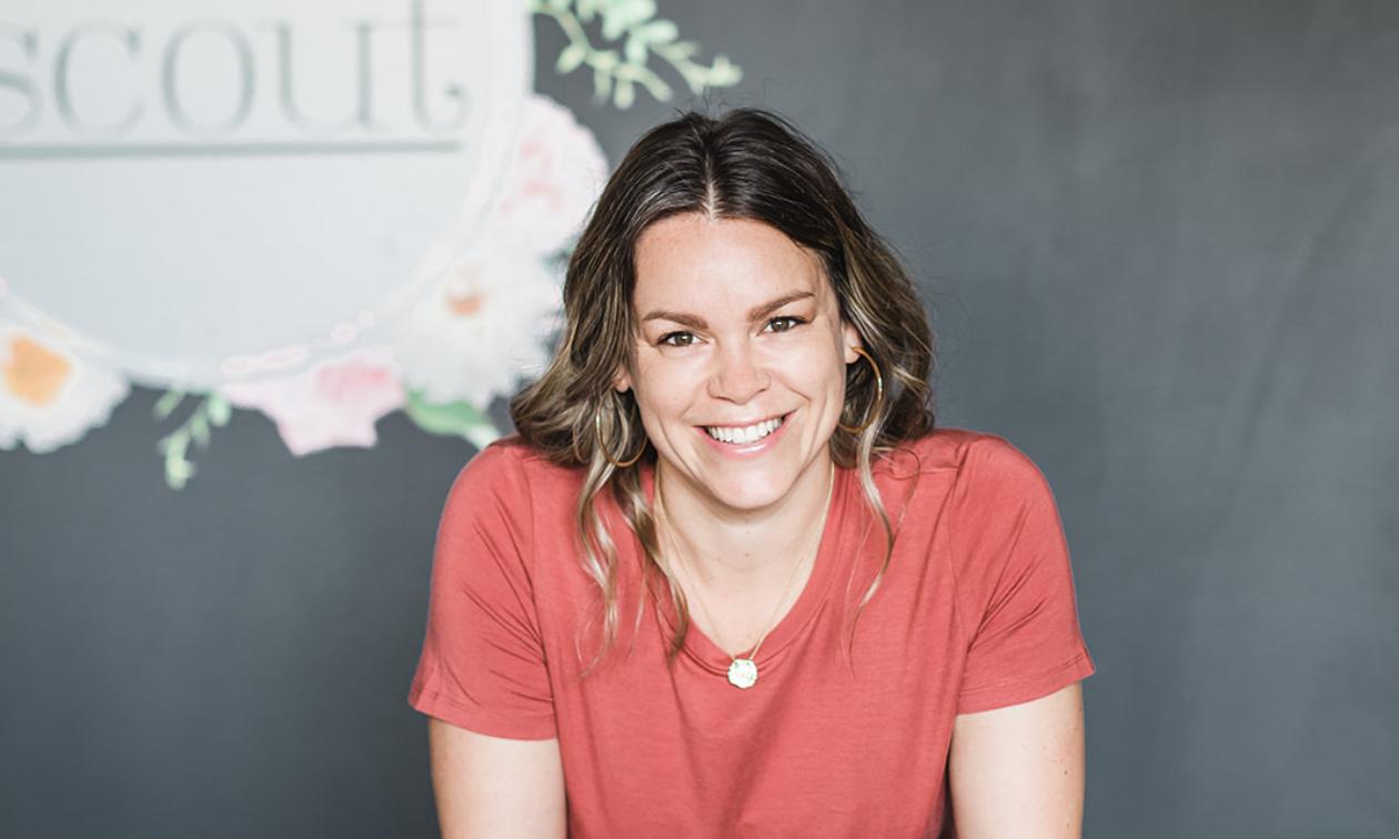 Laura Price smiles wearing a pink shirt.
