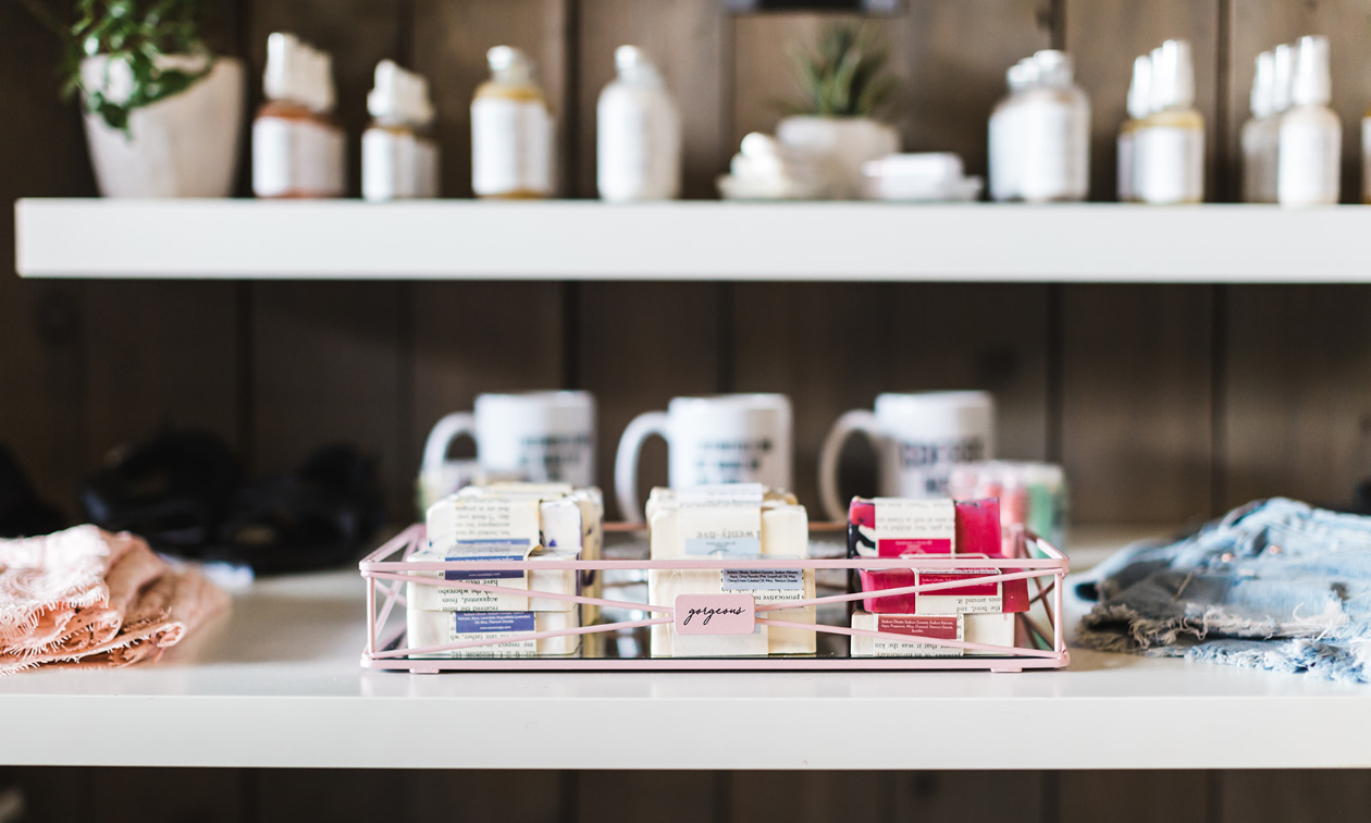 Soaps and lotions are on display on a counter.