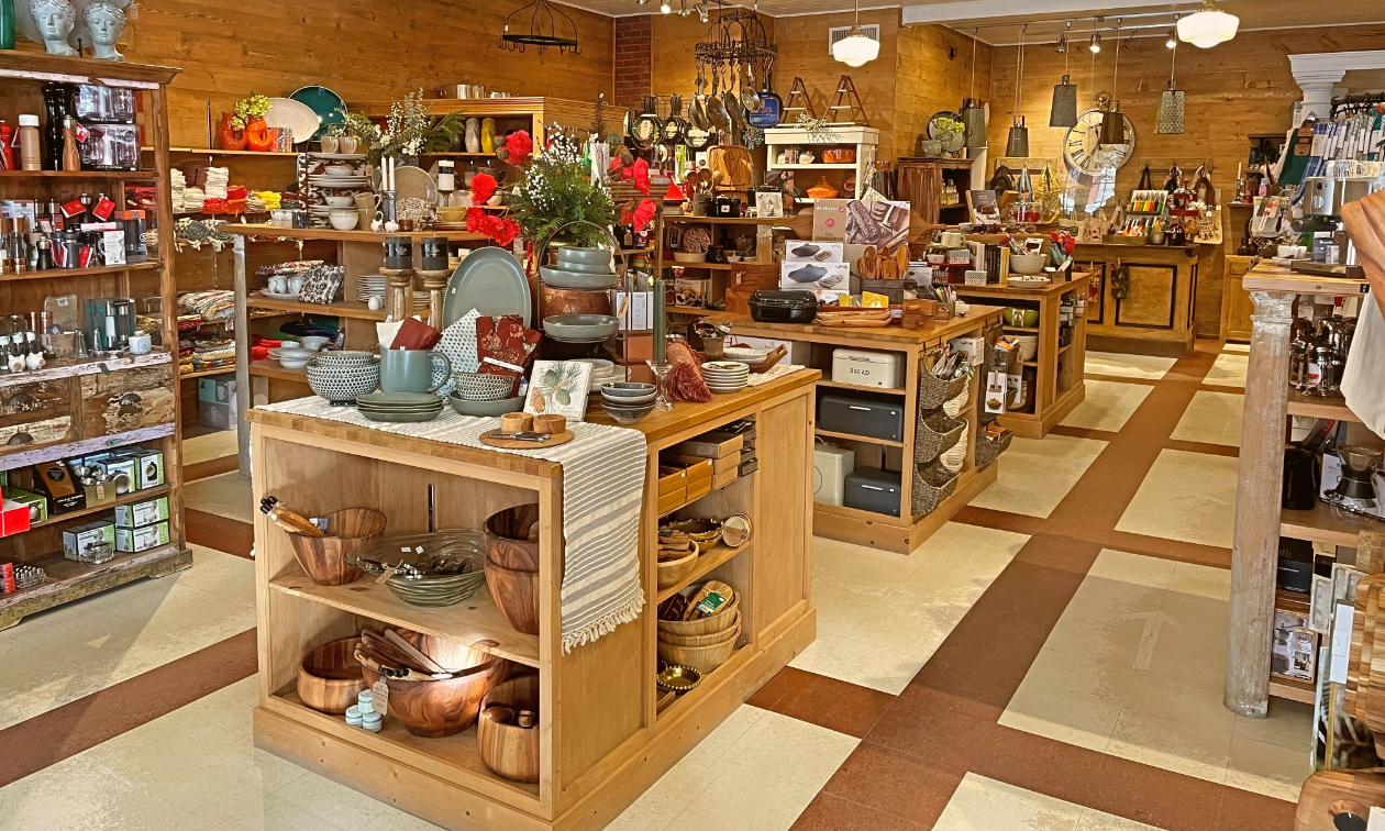 The interior of The Grater Good has shelves of cookware, bakeware and tableware.
