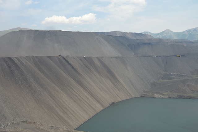A view of the open pit, with a lake at the bottom.