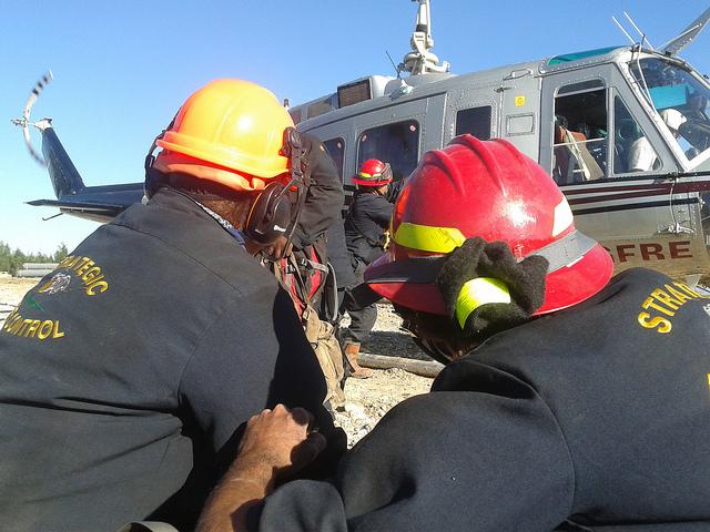 Joe Windels opening helicopter door on way to fight fire in Northwestern Alberta.