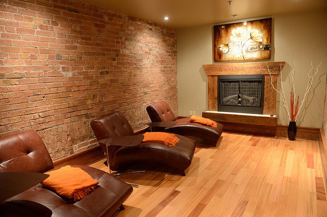 The relaxation room has three comfortable lounge chairs and a fireplace.