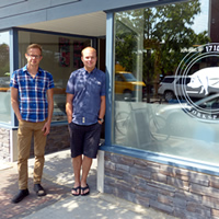 Lee Tengum and Nathan Troxel standing in front of 1710 Workspace in Cranbrook.