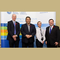 Jim Burpee, President and CEO of the Canadian Electricity Association (left) and Employment Minister, the Honourable Jason Kenney (right) flank Columbia Power representatives, President and CEO Frank Wszelaki (centre left) and Health and Safety Manager, Andre Noel (centre right)