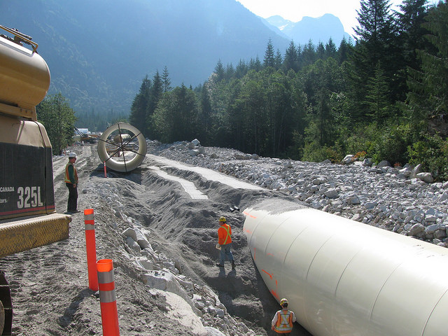 Backfilling a large diameter pipe for a hydroelectric project