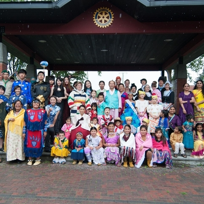 people gathered wearing traditional clothing from various cultures