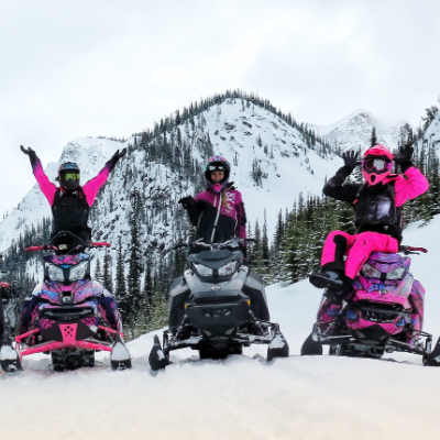 Brittney Dickson (on left) takes some women out for a ride during one of Stay Wild Backcountry Skills' Ladies Sled Shred Camps.