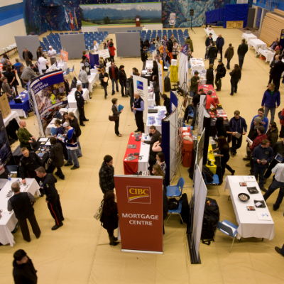 Employers and job seekers explore the Career and Job Fair.