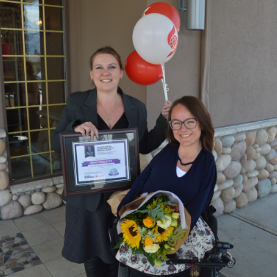 (L to R) Amie Lubbers, sales co-ordinator for Kootenay Business magazine, presents one of three Influential Women In Business awards to Grace Brulotte, president and program manager for FIRE: Fernie Adaptive Snow Program.