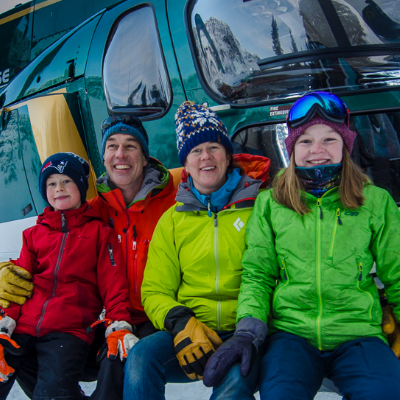 (L to R) Alden, Mark, Sarah and Grace Yancey sit on a helicopter