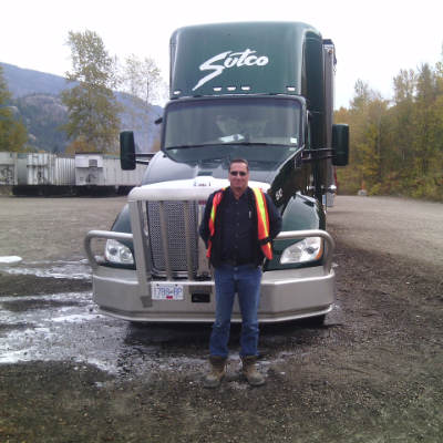 Jim Hymer stands in front of his truck