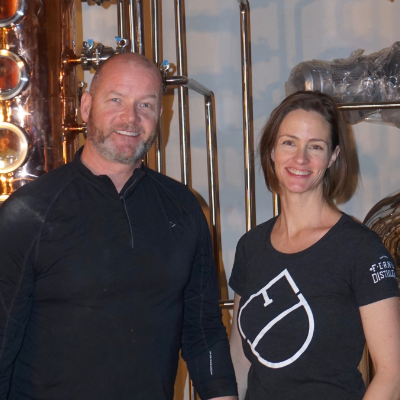Andrew Hayden and Jillian Rutherford stand together in their distillery.