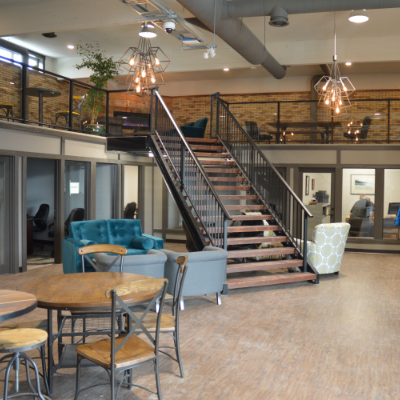 The Ground Floor Co-working Space interior is shown with a large staircase.