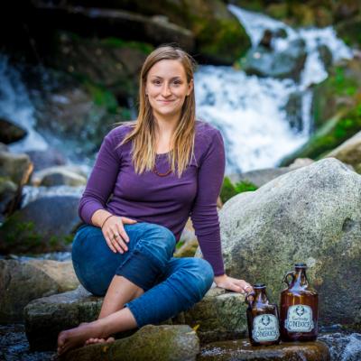 Lavinia Lidstone sits near a waterfall