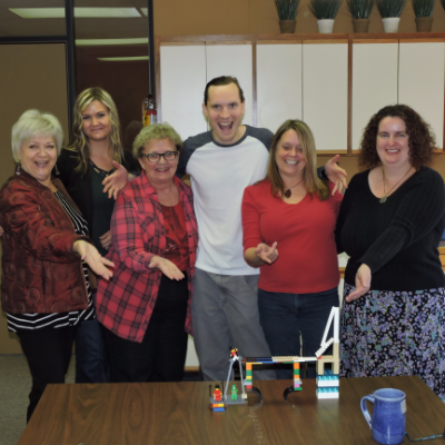 (L to R) Marie Milner, Kirsten Armleder, Sandra Albers, Kyle Born, Virginia Rasch and Julie Matchett celebrate a day of teambuilding with Life Roots Consulting's Lego Serious Play.