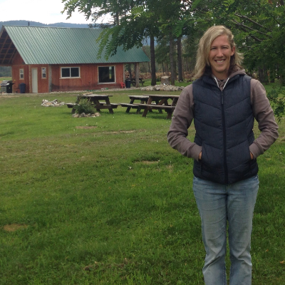 Rebekah Tebrinke stands in front of her business, PV Ranch Getaway, north of Grand Forks.