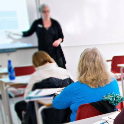 Adults learn in a classroom