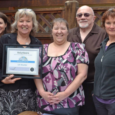 Ulli Mueller holds her 2016 Volunteer of the Year certificate with Community Futures staff members Andrea Wilkey, Val Radcliffe and Don McCulloch, and Board Director Frances Swan