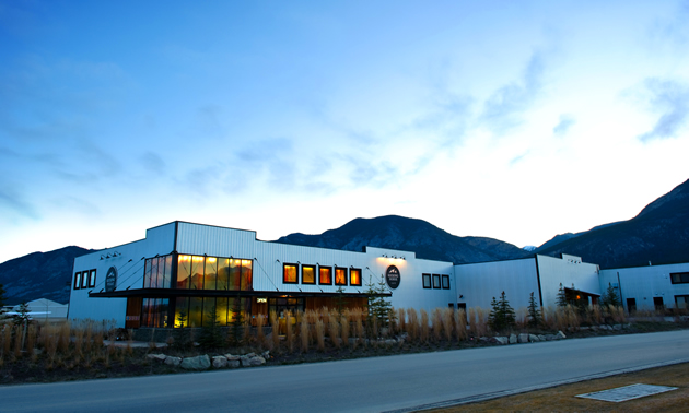 A picture of Kicking Horse Coffee headquarters with a mountainous background.