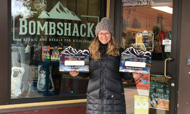 Alicia Gray is proud to show off her 2018 Trail Chamber of Commerce awards for Emerging Entrepreneur and Business of the Year.