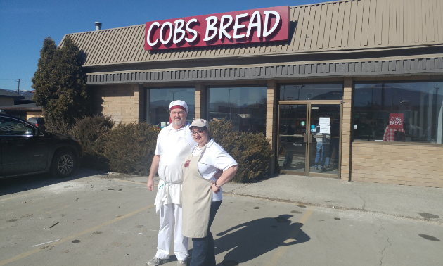 Rod and Tamara Duggan are standing out in front of the new store.