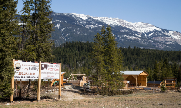 The BC School of Log Building and Stonehouse Woodworks in the midst of mountains in Golden, B.C.
