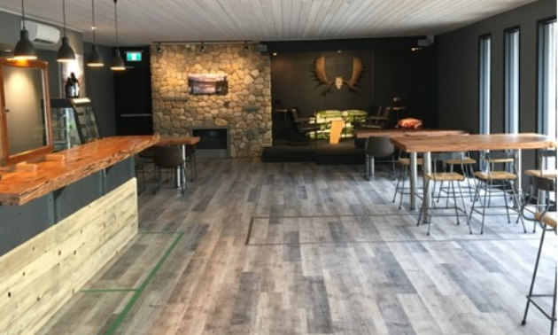 Erie Creek Brewing Company's lounge features hand-forged stools, one-of-a-kind wood accents and a rock gas fireplace made with stones from the Salmo River.