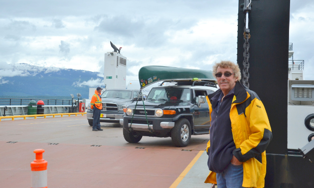 John Harding stands on one of his ferries