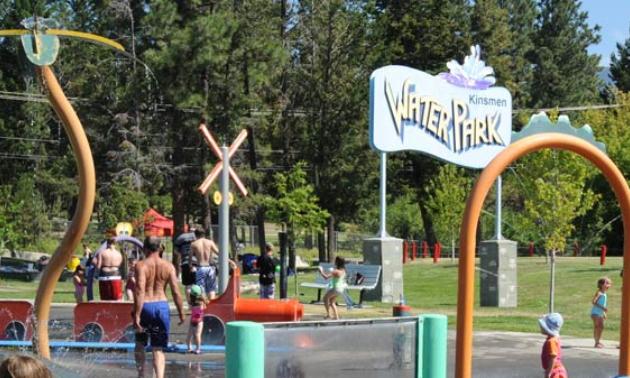 Kids play in a spray park.
