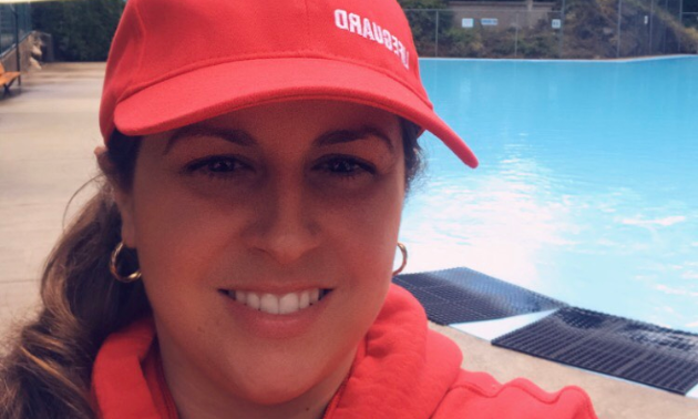 Sonya Pope wears a red lifeguard hat.