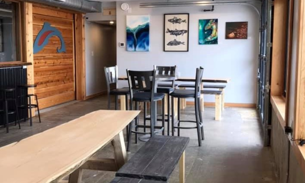 The interior of Tailout Brewing has pictures and images of fish on the walls.