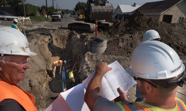 Workers plan what to do on 2nd Street South
