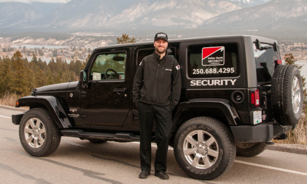 David Read stands next to a Jeep