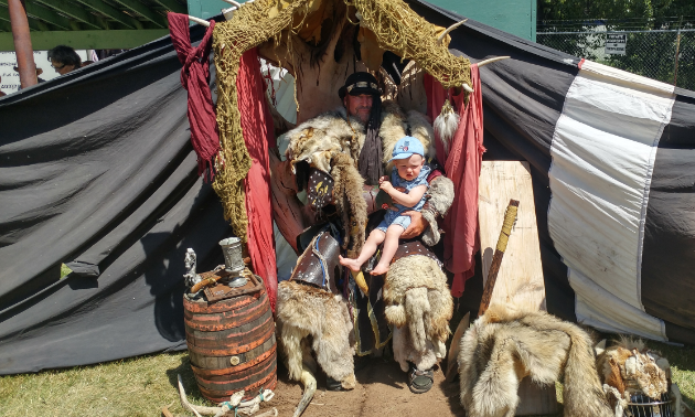 My son, Augustus, isn't quite sure what to think about being held by an intimidating Viking as he sits on his impressive throne.
