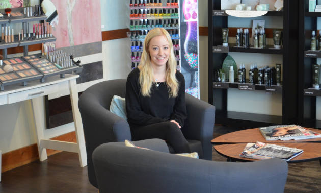 Lindsay Reynolds smiles in her store, Three Sisters Day Spa.