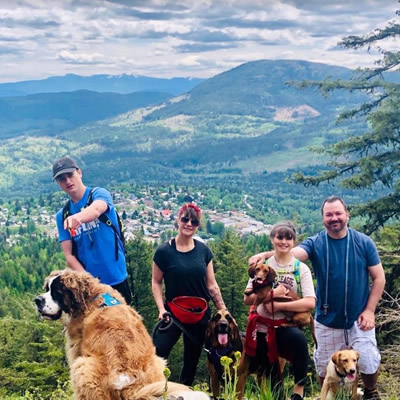 Cooper Baley hiking on a hillside with his family.