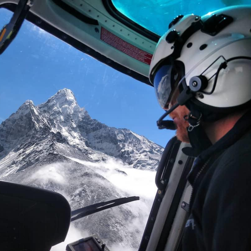 Eric Ridington looks out his glider canopy window to see a huge snow-covered mountain in front of him.