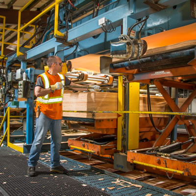 Picture of worker in wood factory.