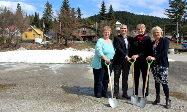 From left: Jan Morton (president, Lower Columbia Affordable Housing Society), Johnny Strilaeff (CEO, Columbia Basin Trust), Minister of Children and Family Development and MLA for Kootenay West Katrine Conroy and Mayor of Rossland Kathy Moore break ground at a new affordable housing development in Rossland on May 1, 2018.