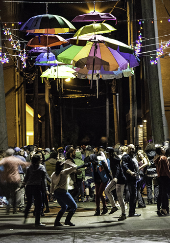 Volunteers and artists celebrate the success of the first Luna Fest by dancing in the alley.