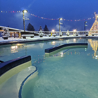 Ainsworth Hot Springs pool on a snowy winter night.