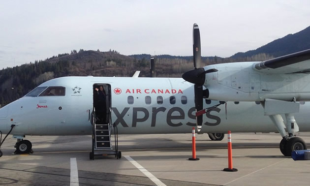 An Air Canada Express airplane on tarmac at airport.