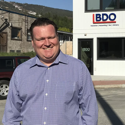 Alan Rice stands outside the new BDO office in Kimberley