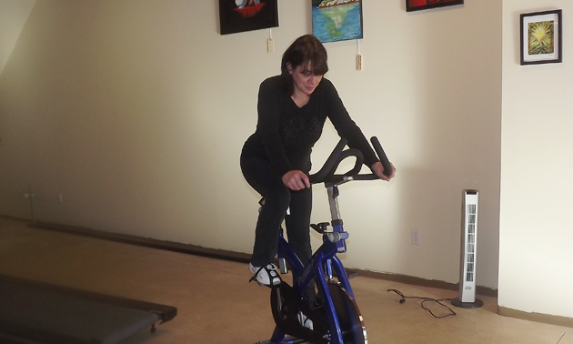 woman on an exercise bike in a gym