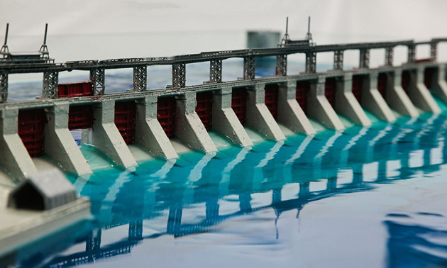 A 3D printed structure model of a dam - the model is set up on a shake table to represent how dams respond during an earthquake.