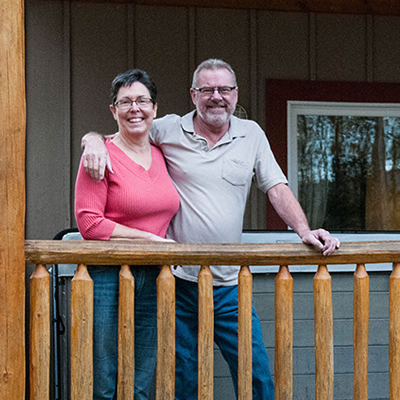 Gail and Lorne Knutson stand in front of the  duplex that contains their bed-and-breakfast suite, B&B@228 in Kimberley, B.C.