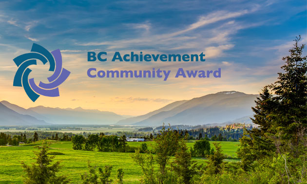 Scenic picture of Creston valley, with logo of BC Achievement Foundation Community Awards.