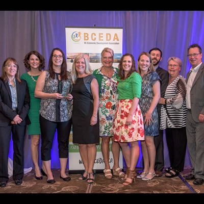 Imagine Kootenay staff and partners proudly display their Marketing Innovation Award at the BC Economic Development Association Summit in Vancouver.