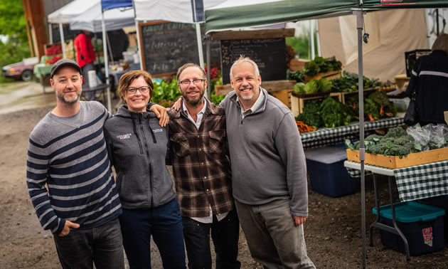 Trust's contribution to Nutrition Coupon Program reduces wait lists, adds five new markets and feeds 225 more families. In photo (L) to (R) Jesse Woodward, Nelson Market Manager, Eric Struxness, Ravine Creek Farms, Jocelyn Carver, Columbia Basin Trust Board of Director and Peter Leblanc, BCAFM.