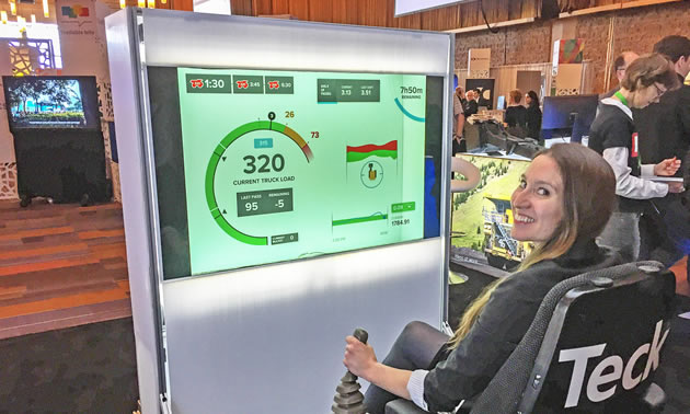 Amanda Truscott, CCO of Rithmik Solutions, tests a view for haul truck drivers at the Teck booth in the summit marketplace.